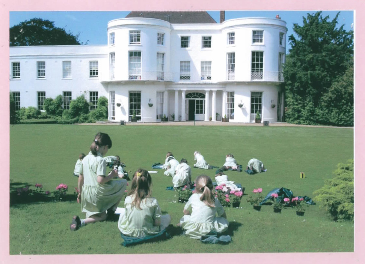 Girls-on-lawn-in-front-of-house
